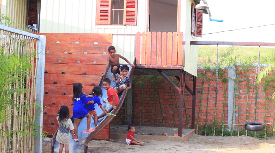 house from the world house project and kids playing around