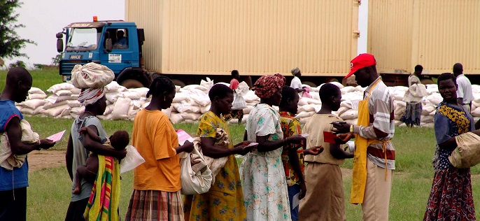 Checking forms to distribute food aid at a camp for internally d